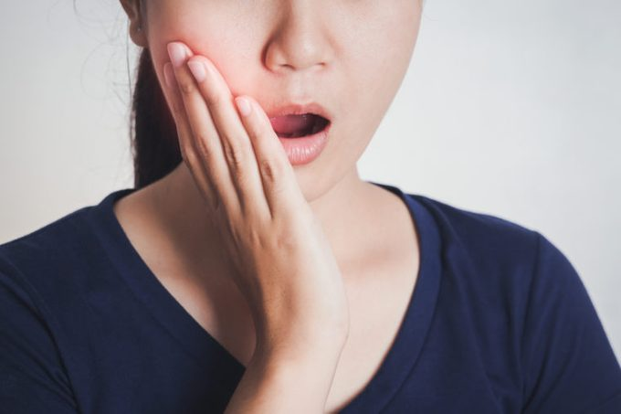 toothache jaw pain asian woman