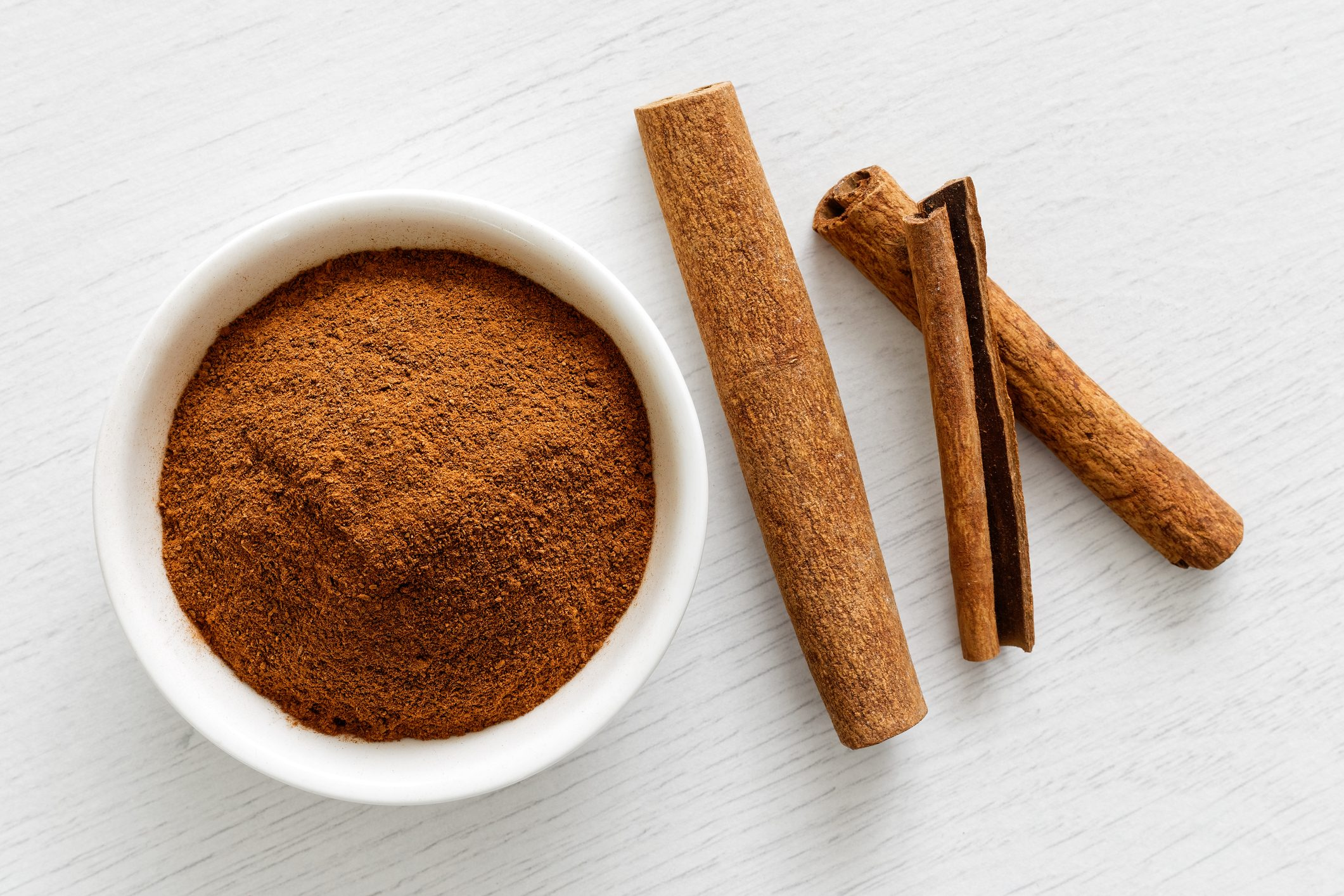ground cinnamon and cinnamon sticks from above