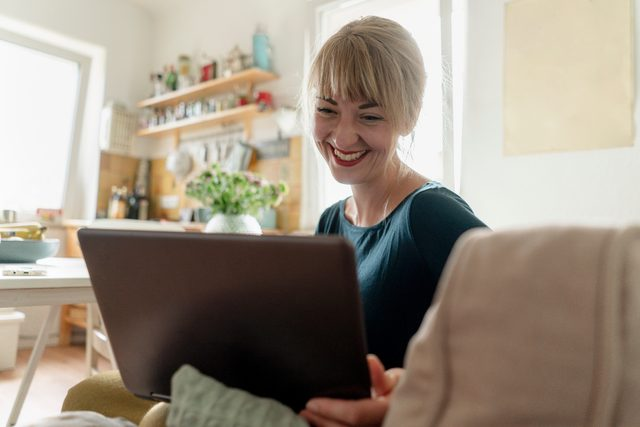 woman on video call with friends and family smiling