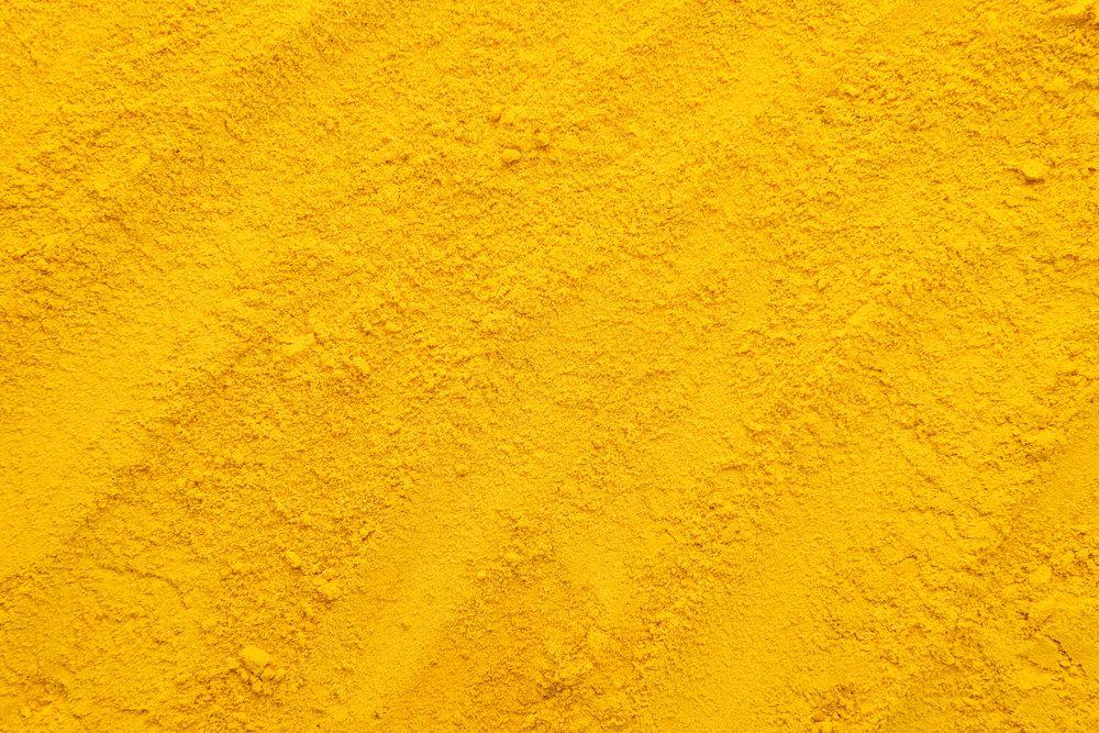 Turmeric powder texture background.