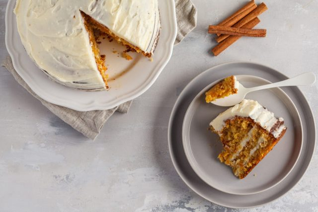 overhead shot of slice of carrot cake cut out of cake