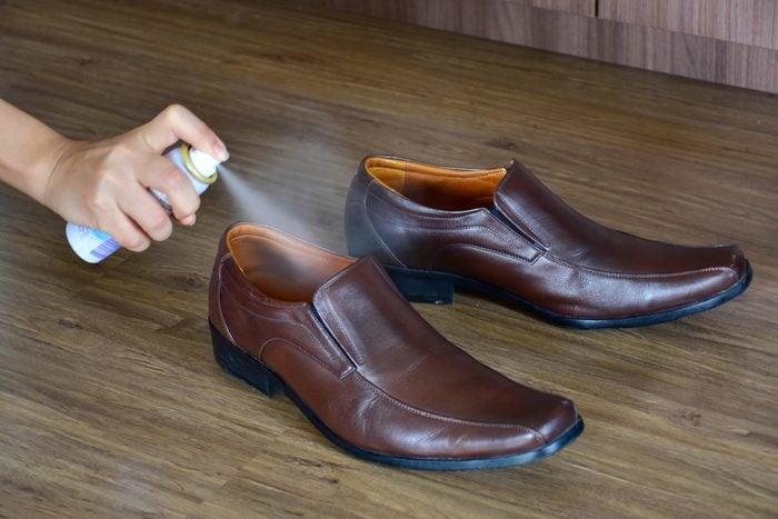 spraying shoes