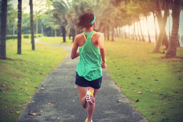 woman running on a path in the park