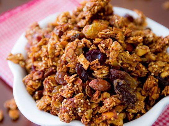 Apple spice quinoa granola in a white bowl.