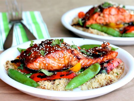 Sweet teriyaki salmon with quinoa stir fry meal.