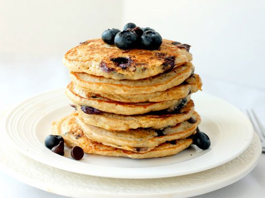Stack of blueberry chocolate chip quinoa pancakes.