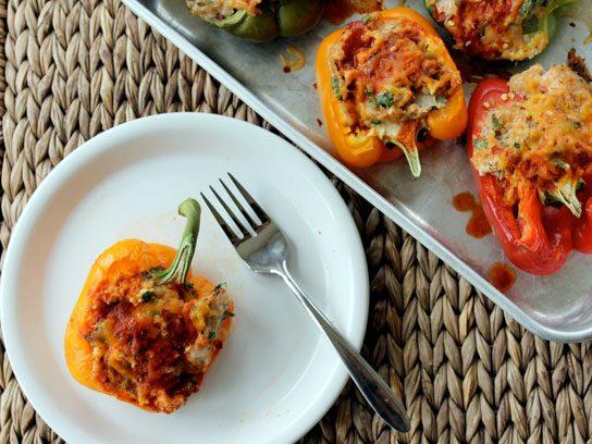 Enchilada chicken quinoa stuffed bell peppers.
