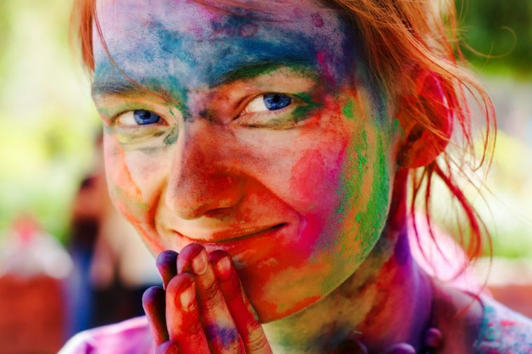 holi festival woman with colors on face rainbow