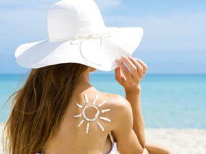 woman with sunscreen on beach