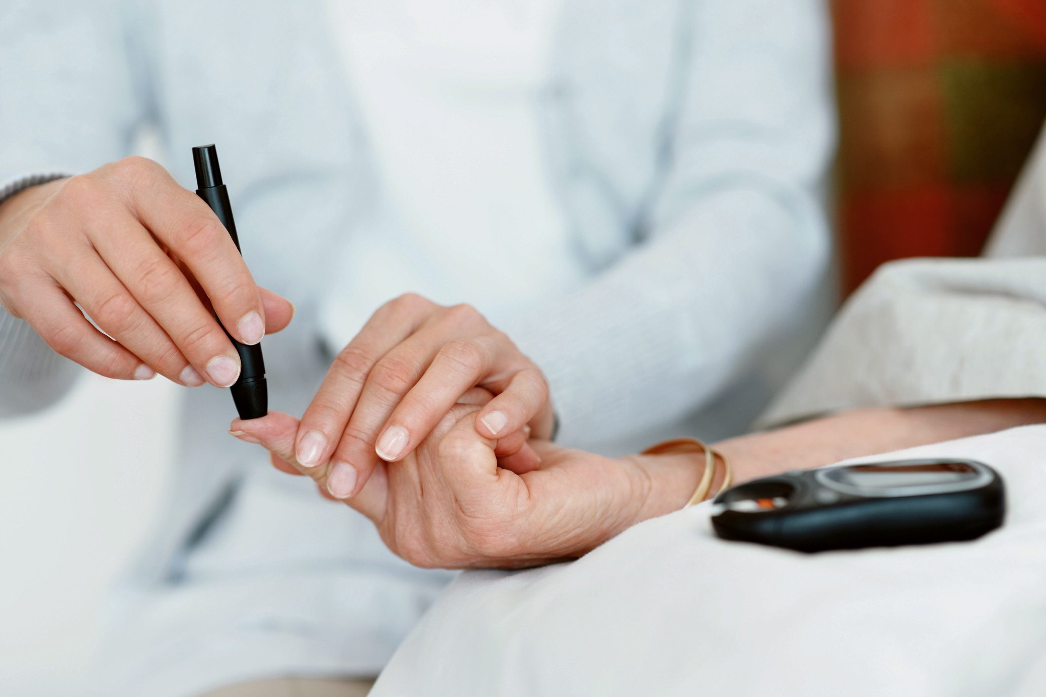 doctor testing patient for diabetes