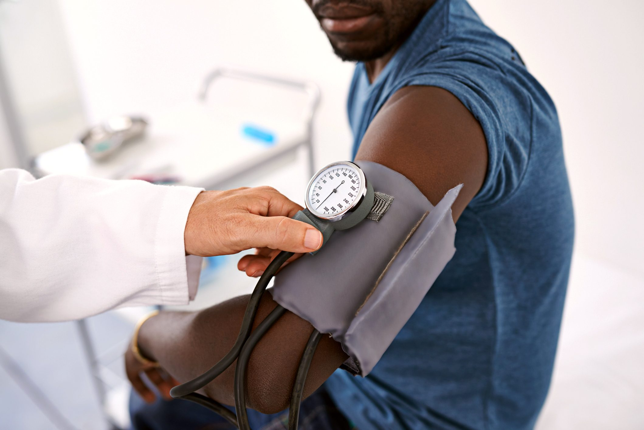 man getting his blood pressure taken