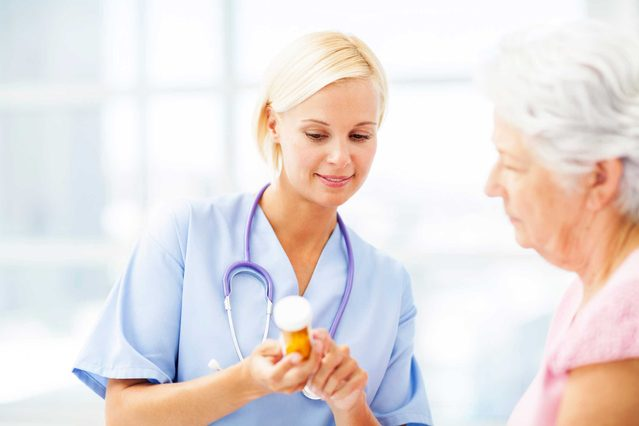 female healthcare working explaining prescription to patient