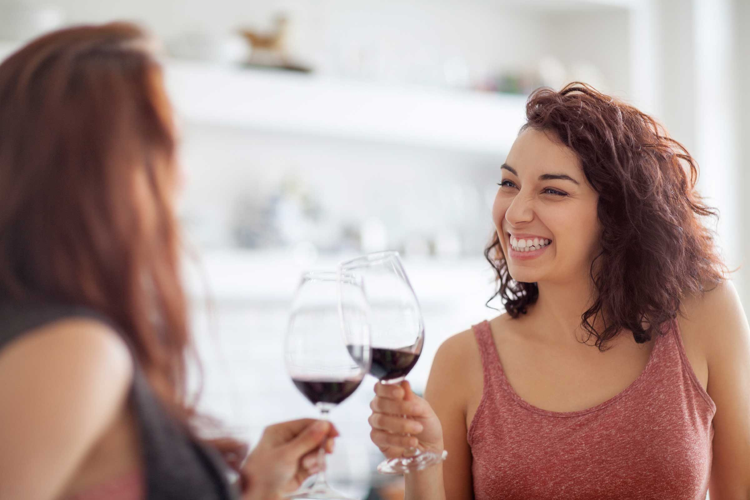 two women toasting with wine