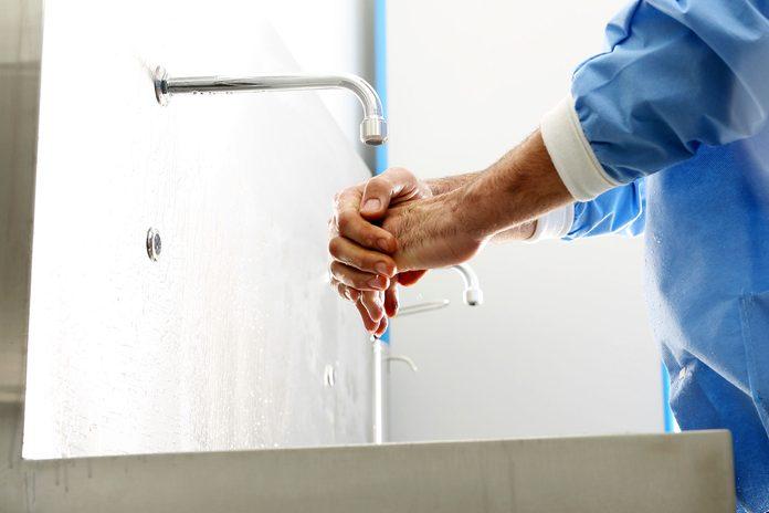 medical staff washing hands