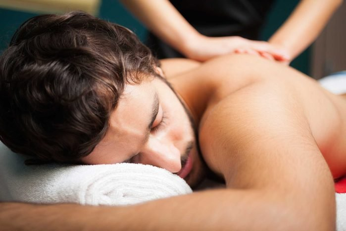 guy with beard getting a massage