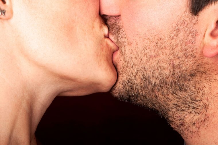 close up of a man and woman kissing