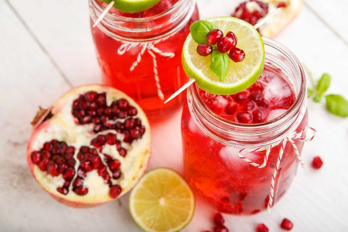 Mason jars with pomegranate and lime drinks