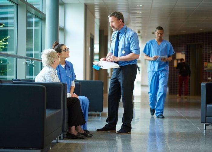 doctors talking to patient in waiting room
