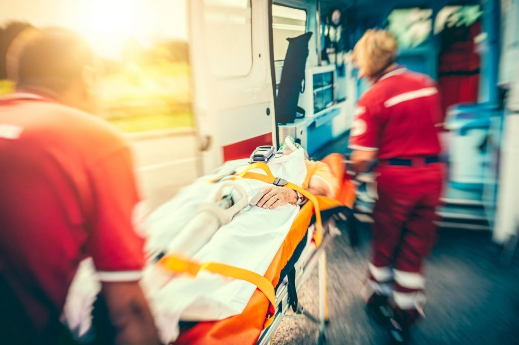 EMTs putting a patent into an ambulence