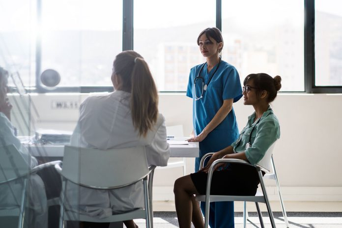 hospital staff meeting around a table
