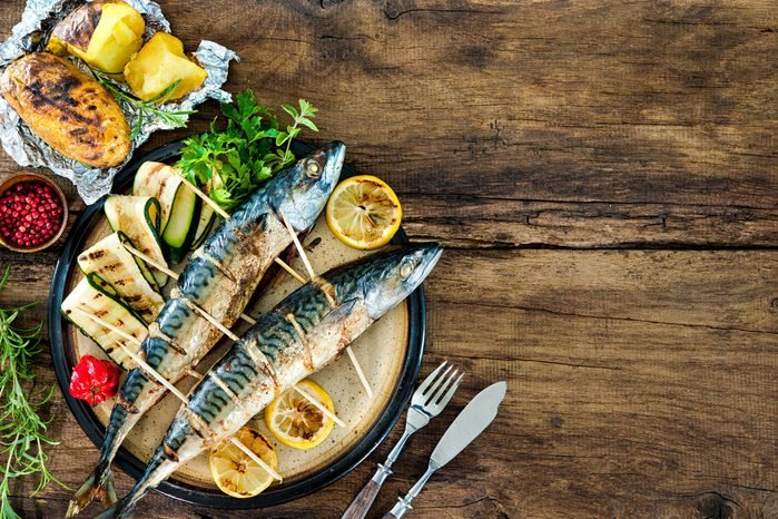 two fresh mackerel fish with vegetables