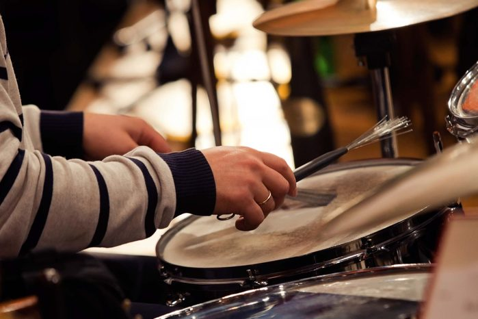 close-up of hands playing the drums