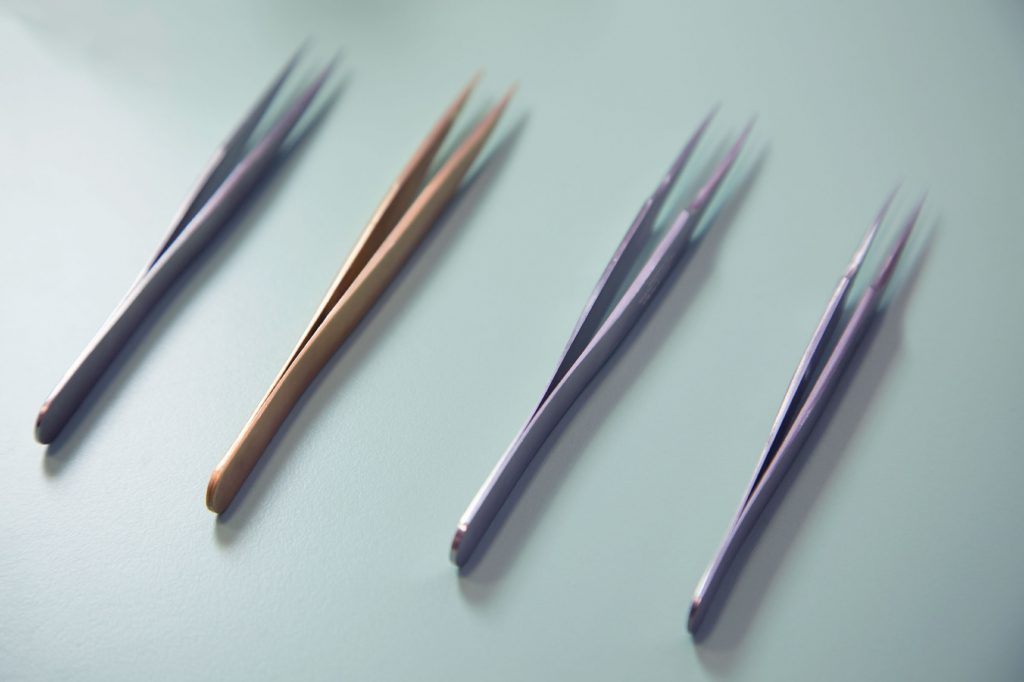 four pairs of tweezers