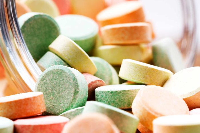 pile of different colored antacid pills