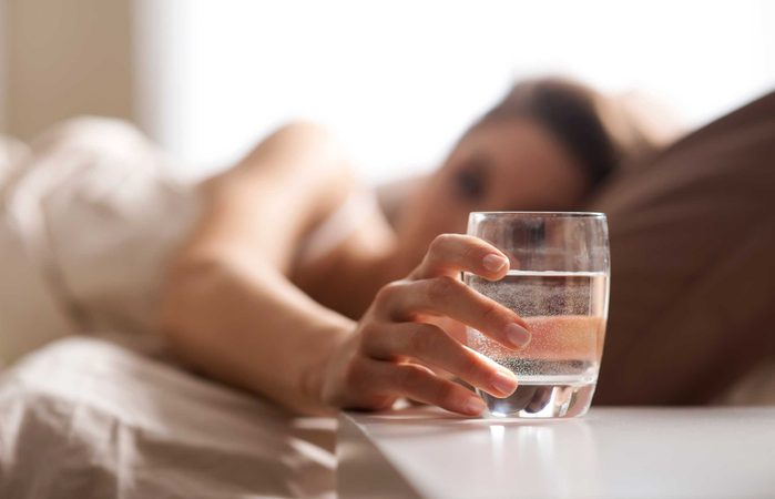 glass of water next to bed