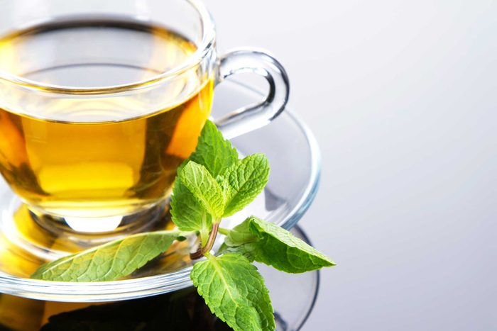 lovely cup of tea with mint on side