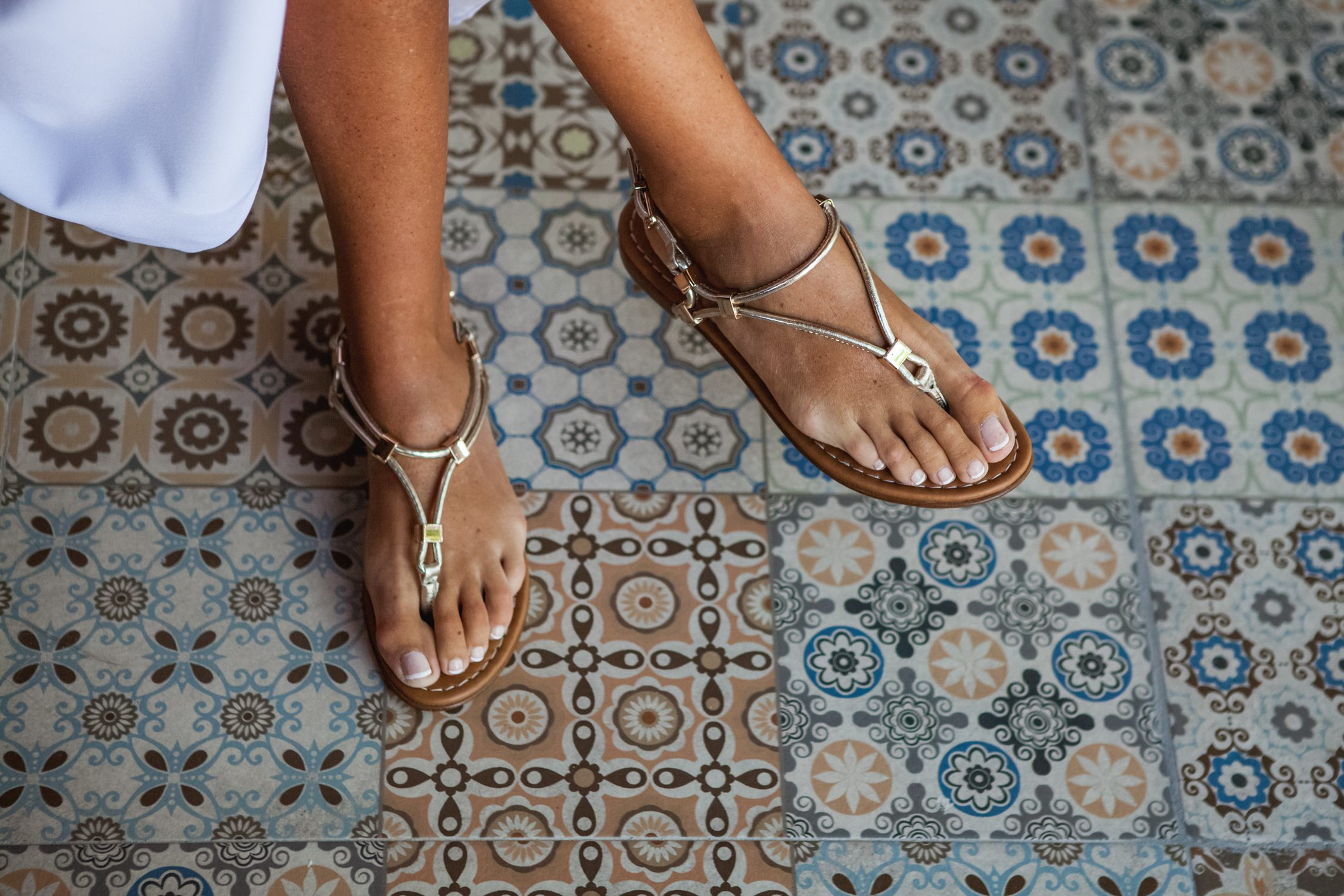 close up of sandals on woman's feet