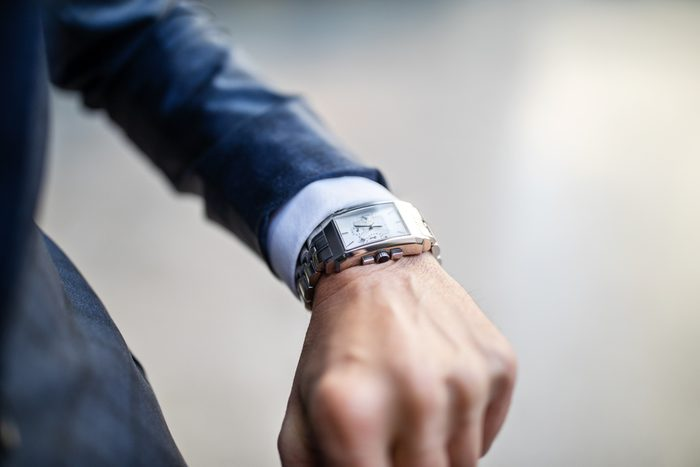 close up of watch on business man's wrist