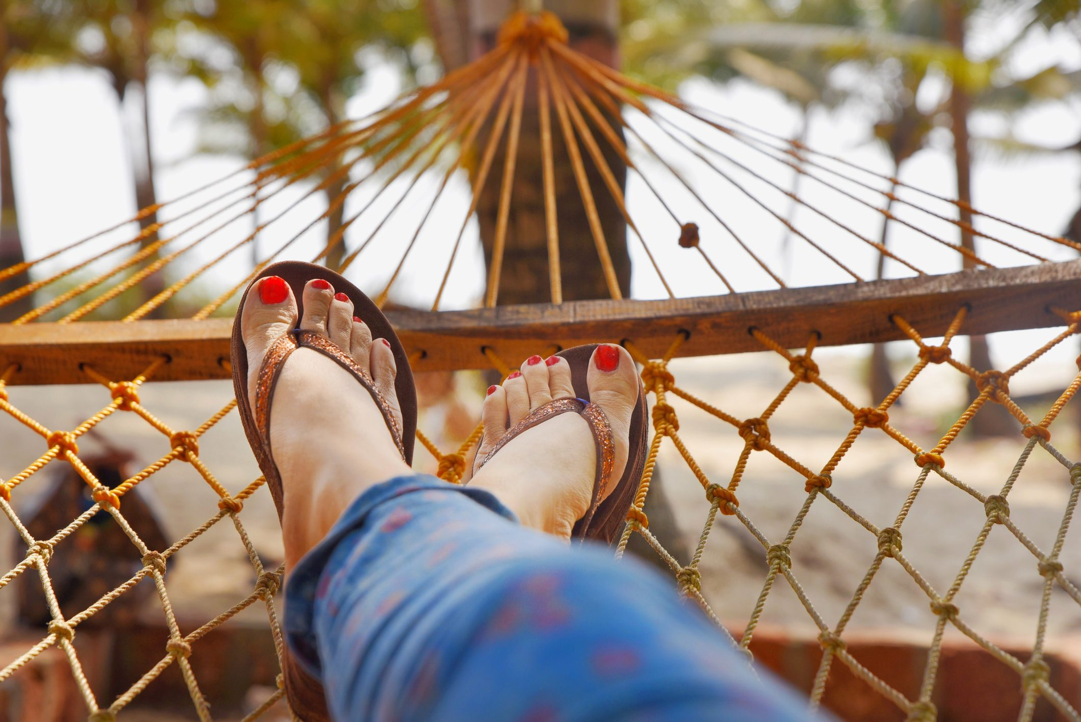 low section of woman resting on a hammock