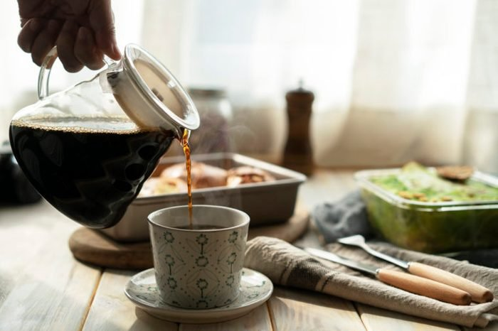 coffee pot pouring into cup