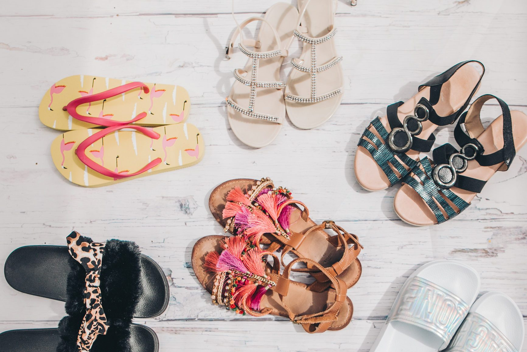 overhead shot of various sandal shoes