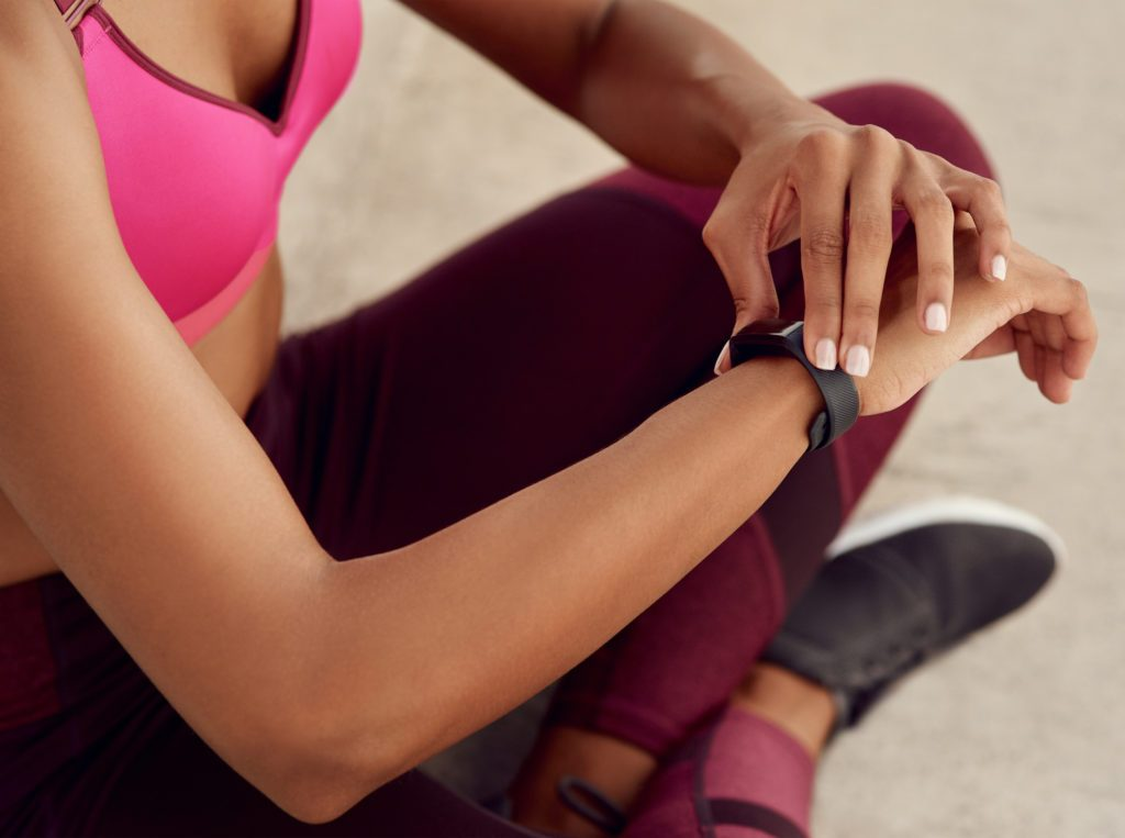 close up of woman checking fitness tracker watch during workout