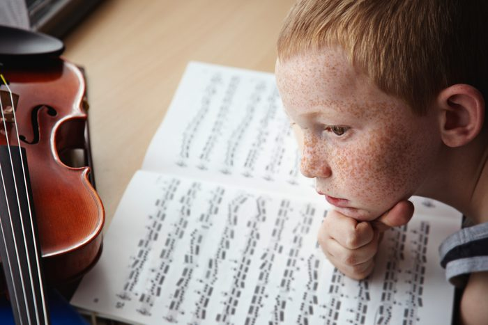 child having trouble focusing on playing instrument