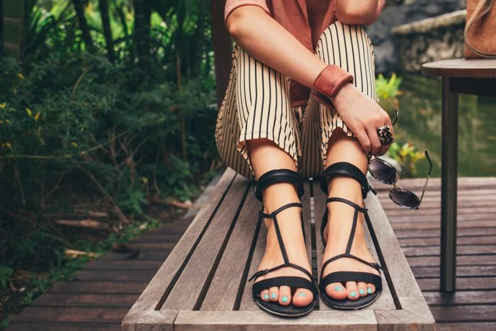 close up of woman's feet wearing sandals