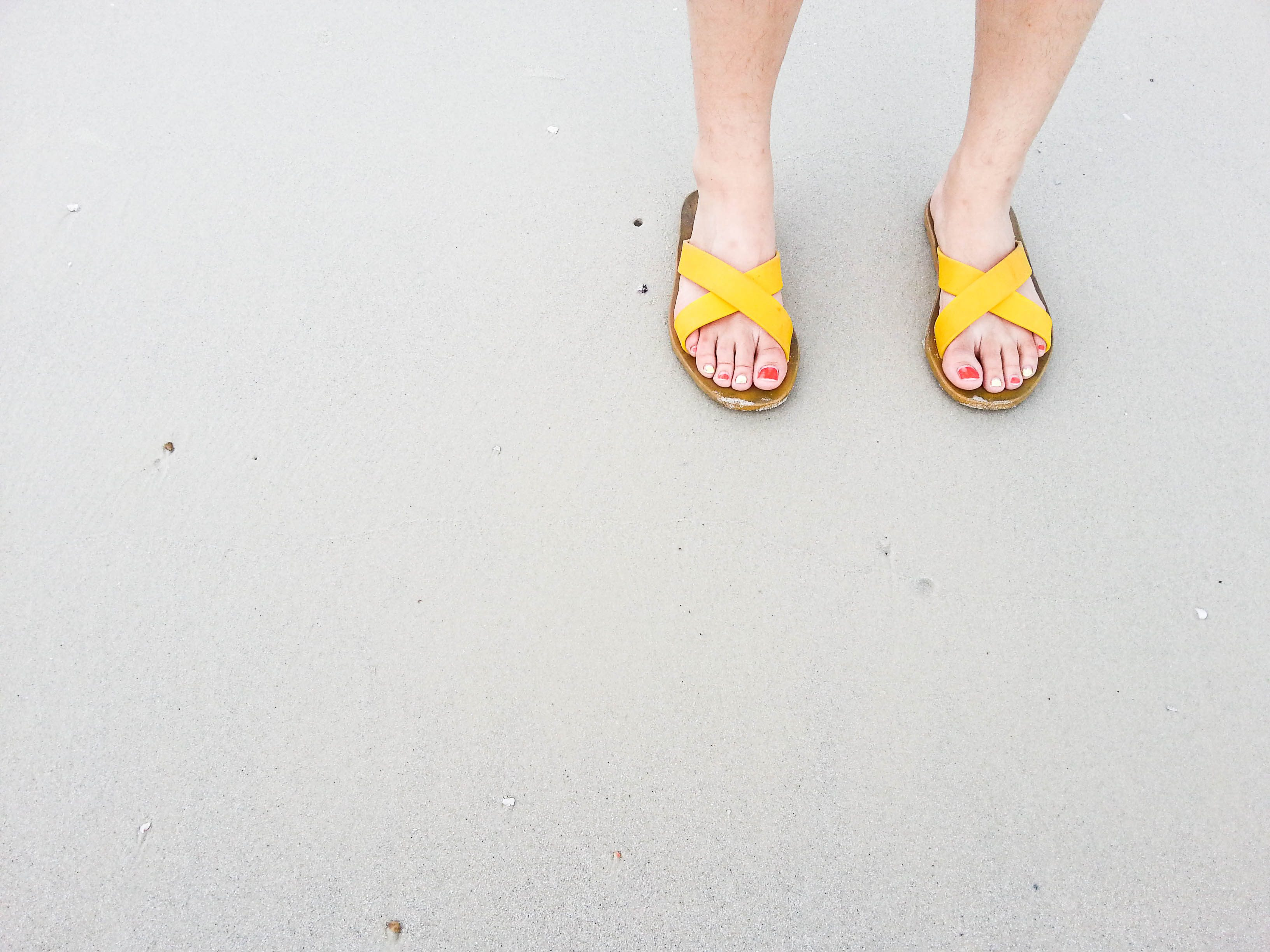 woman wearing yellow sandals
