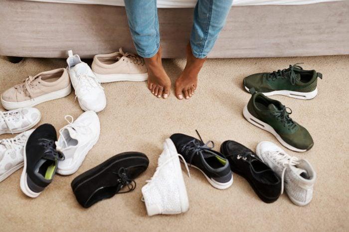 sneakers surrounding feet