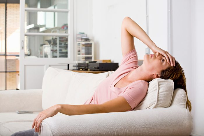 woman distressed at home on couch