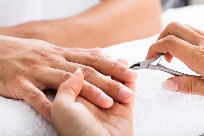 close up of manicure cuticle cutting