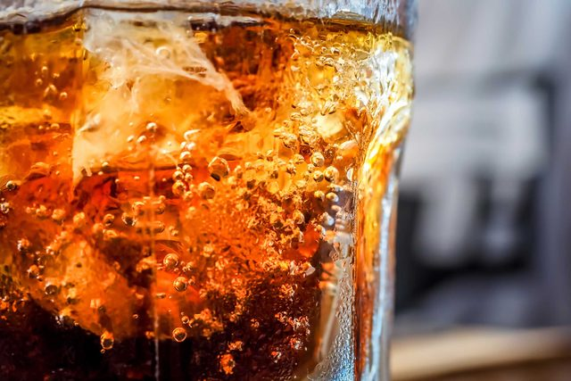 closeup of a glass of cola and ice