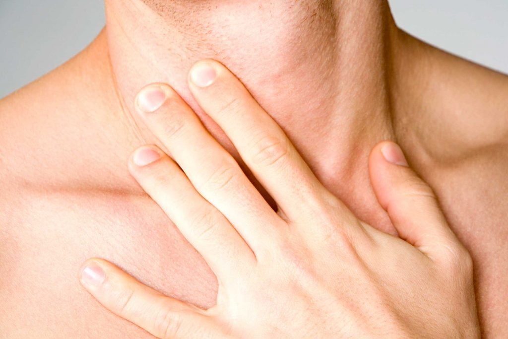 woman's hand on her clavicle