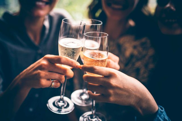 people toasting with champagne flutes