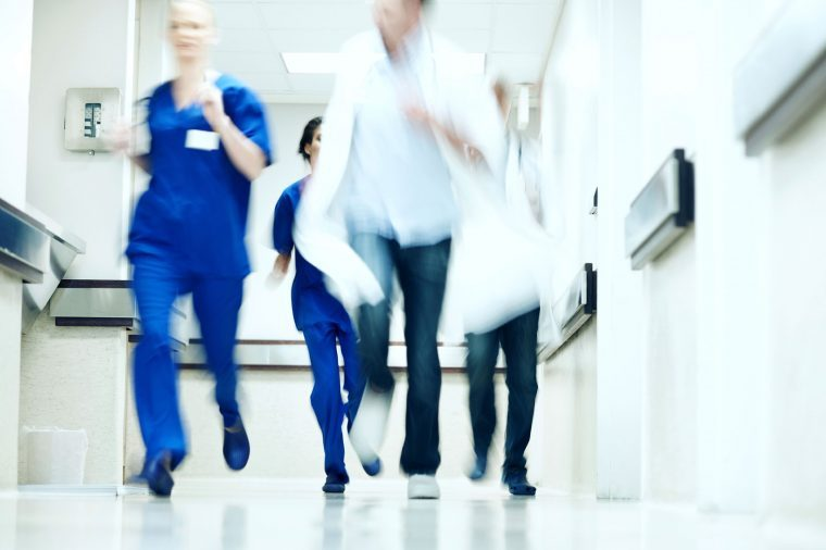 nurses running in hospital corridor