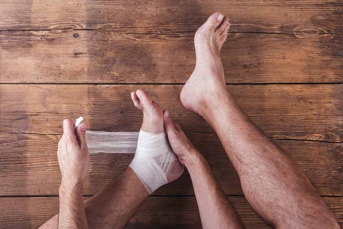 Man bandaging foot and ankle