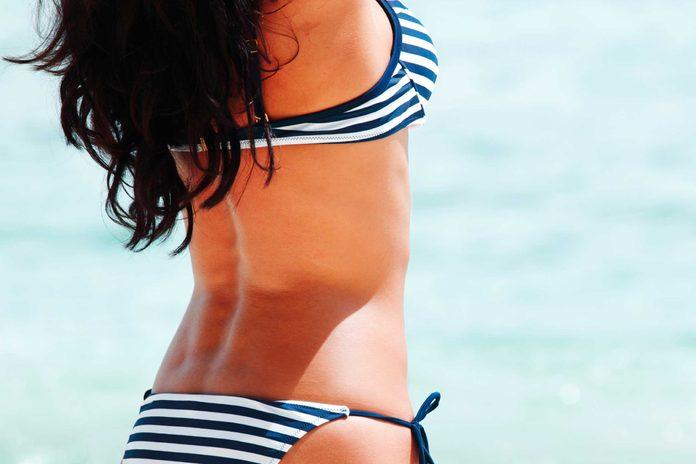 A shot of a woman's torso in a bikini.