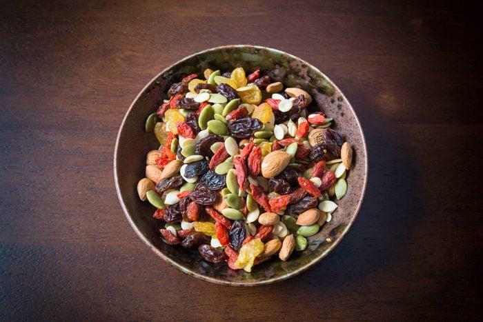 bowl of healthy snack, raisins nuts