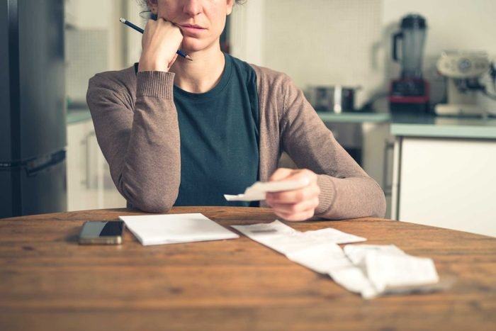 woman doing bills